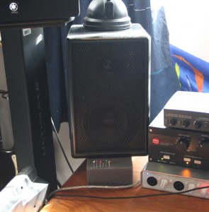 "Custom nearfield monitor on foam upon desk, 4"" bass driver."